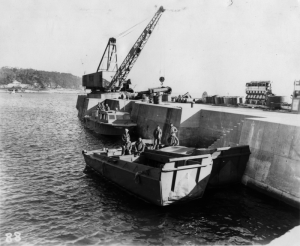 The boat dock with the picket and two Higgins boats. Note the large crane, which Gerry never saw used.