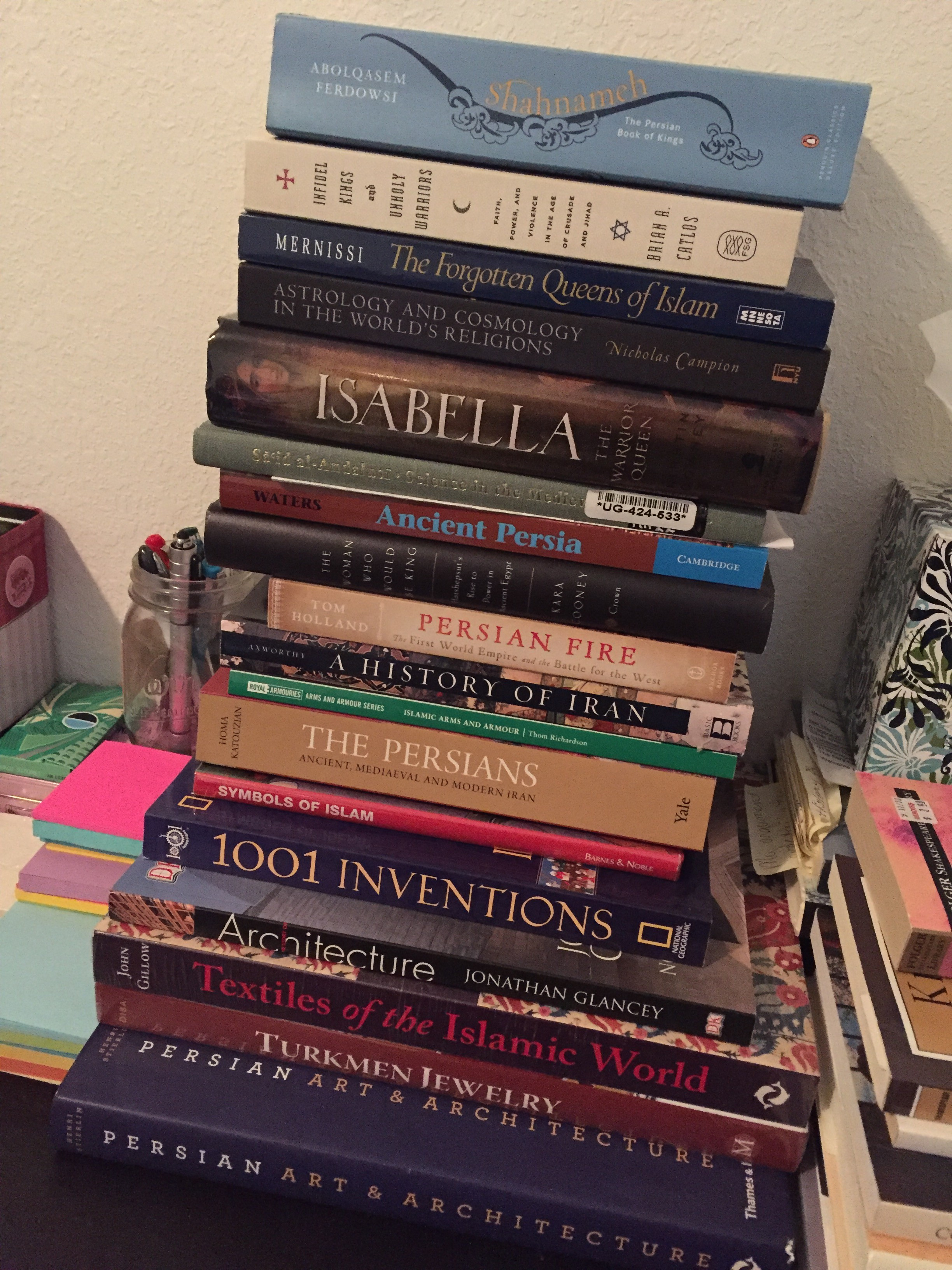 Stack of books, all non fiction titles.